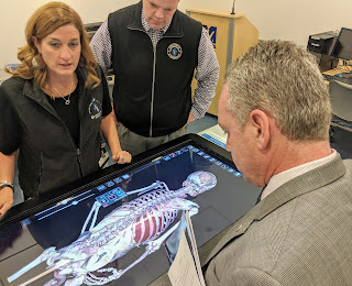 State Rep Jeff Roy in one of the UMass Medical classroom with an interactive system of the body