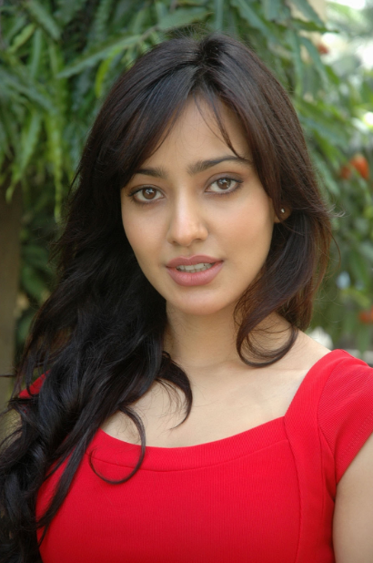 Neha Sharma looking sexy in red dress