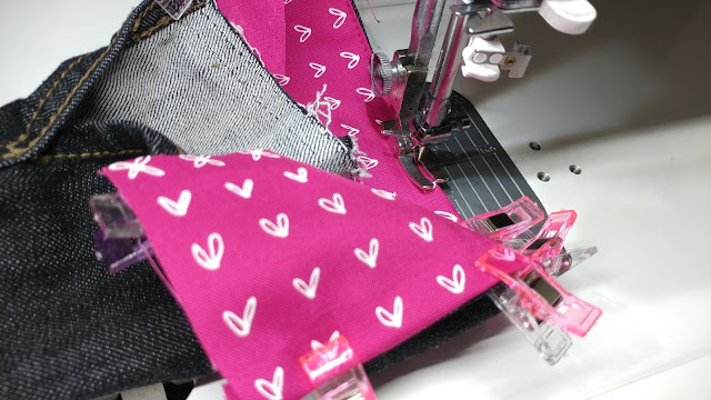 Sewing new cuffs on upcycled denim jacket with Aurifil thread and hot pink Blueberry Park fabric