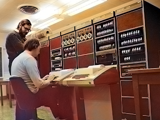 Ken Thompson (sitting) and Dennis Ritchie (standing) at PDP-11