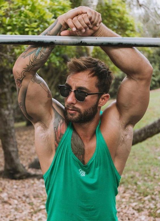 dude-shades-arms-up-huge-muscle-biceps
