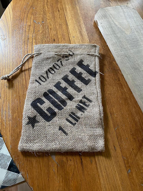 Photo of burlap sack stenciled with Coffee stencil