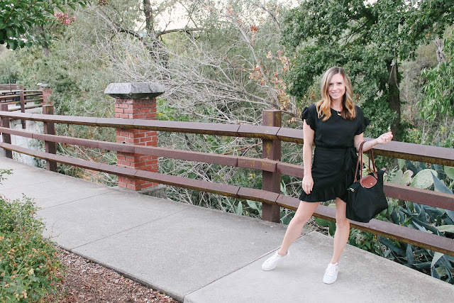 Mini dress and sneakers paired for a perfect summer to fall look that is equal parts girly and equal parts athleisure