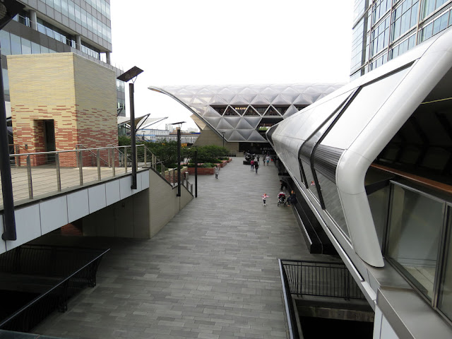 Adam's Place and the elevated walkway to Crossrail railway station, Seen from North Colonnade, Canary Wharf, London