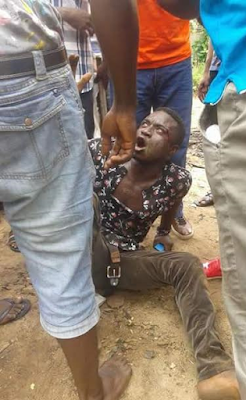 Photos of a suspected armed robber who was beaten by a mob in Owerri