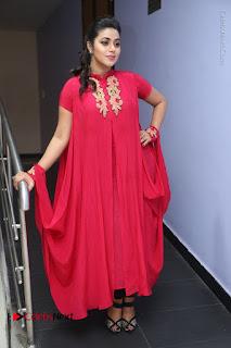 Actress Poorna Latest Stills in Red Dress at Rakshasi First Look Launch  0295.JPG