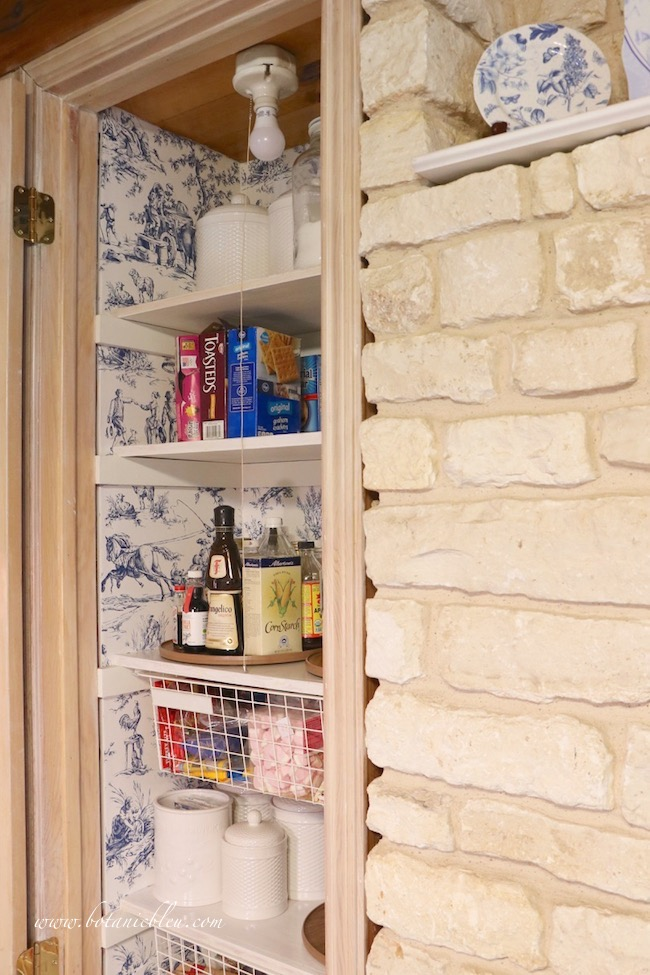 French Country Pantry Makeover finished view with adjacent stone wall