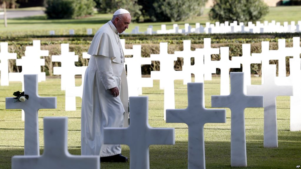 Pope Francis walks past marble crosses at the American military cemetery in Nettuno, Italy, 02 November 2017.