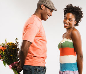 black_man_giving_a_black_woman_flowers