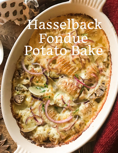 """Food Lust People Love: There are two stars of this recipe for hasselback fondue potato bake: First up are the new potatoes, sliced and roasted, opening up nicely so star number two, the cheese, can melt right inside. The finishing touches of wine and cream, not to mention quick pickled onions, make this dish one you'll cook again and again. This recipe is adapted from one on the .delicious magazine website called hasselback potato bake.  It is described as """"a love affair between crisp, roast potatoes and melted cheese – more specifically fondue."""""""