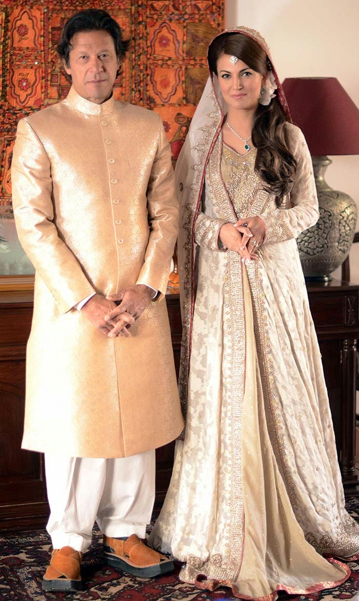 In this handout photograph released by the Pakistan Tehreek Insaf (PTI) party on January 8, 2015, Pakistani opposition leader Imran Khan (L) and new wife Reham Khan pose for a photograph during their wedding ceremony at his house in Islamabad. Pakistani opposition leader Imran Khan wed a TV journalist in a simple ceremony at his Islamabad home January 8, ending years of speculation surrounding the former playboy cricketer widely considered his country's most eligible man.