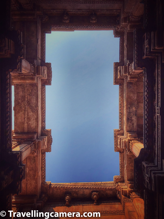 Above photograph shows blue sky of Gujrat through roof-top of 2nd level at Adalaj ni Vav. I loved clicking some of these photographs with my phone camera at Adalaj ni Vav. The whole structure looks awesome and every level of the stepwell is unique. The deep you go, better you appreciate the architecture and the grandness of these stepwells.     A tribute paid to the rich underground structures, which are intricately decorated with sculptures, is that they are said to resemble palaces.