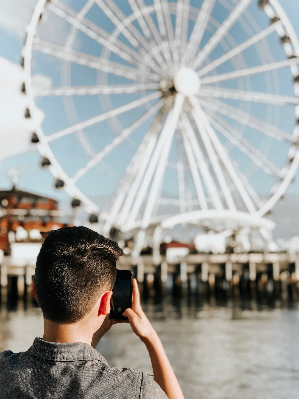 boy with ferris wheel in downtown area