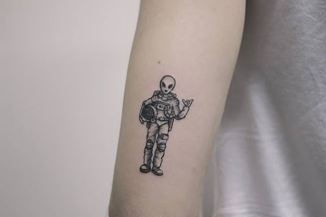 alien astronaut tattoo