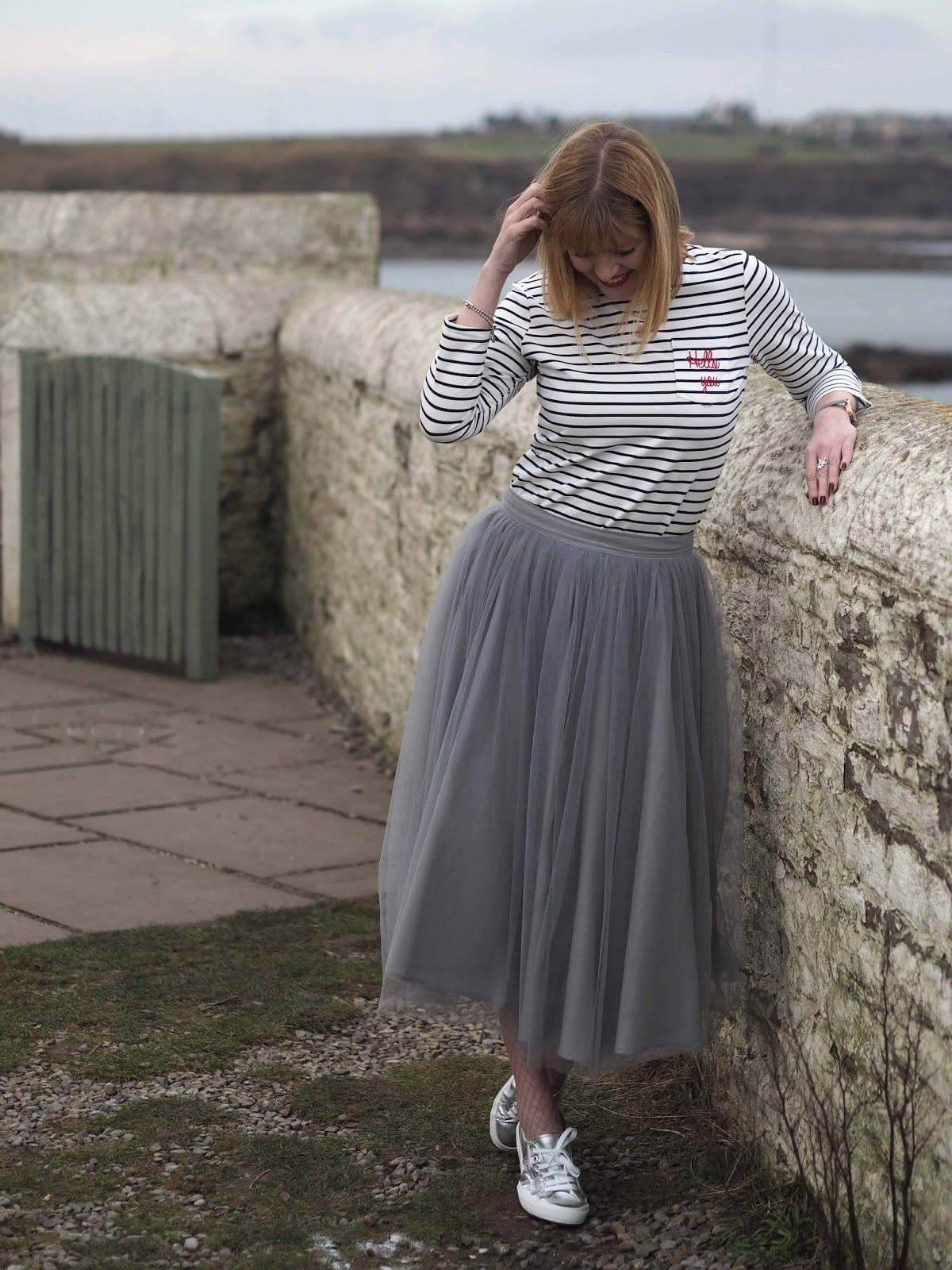 Logo breton top, grey tulle skirt, silver Superga pumps, over 40