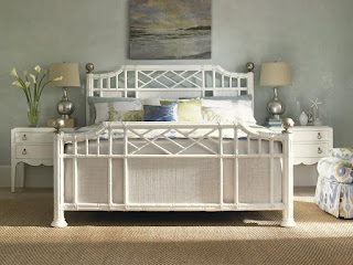 white paneled bed with wovend detail
