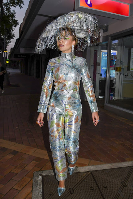 Rita Ora – In a silver patterned jumpsuit out in Sydney