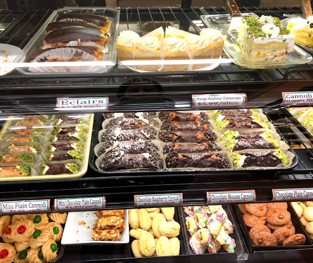 Tenuta's bakery counter is full of baked treats including a variety of cannoli flavors.