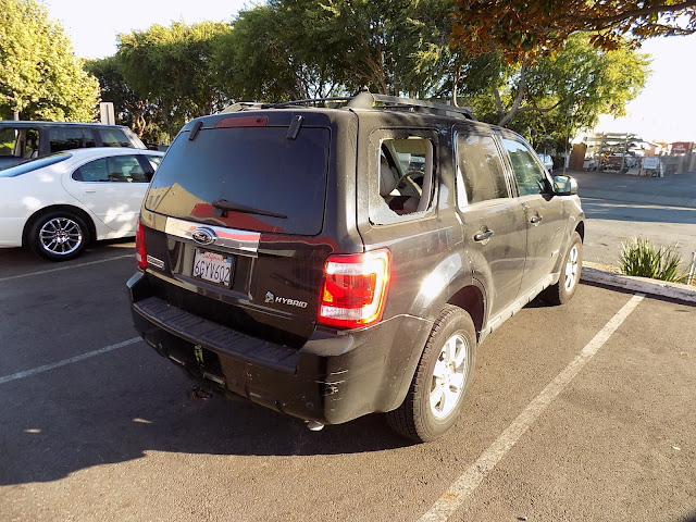 Ford Escape Hybrid with broken window and key scratches.