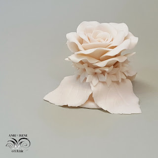 Biscuit porcelain rose.