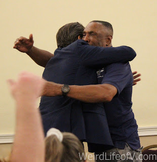 Dirk Benedict gets a hug from Herbert Jefferson, Jr.