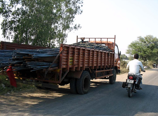trucks carrying rods
