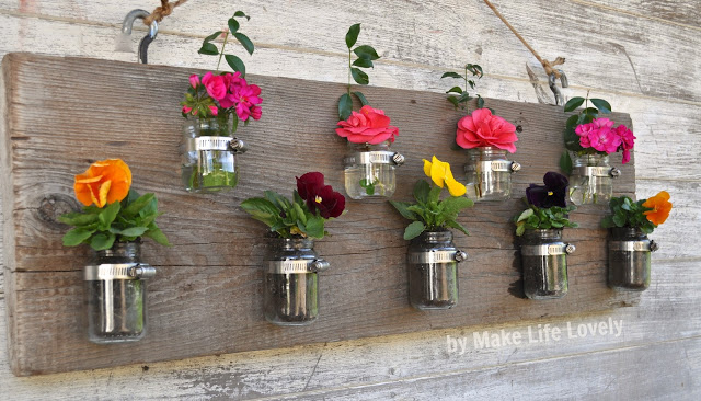 Reuse baby food jars to make a wood vase candleholder decor piece for your home