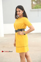Actress Poojitha Stills in Yellow Short Dress at Darshakudu Movie Teaser Launch .COM 0044.JPG