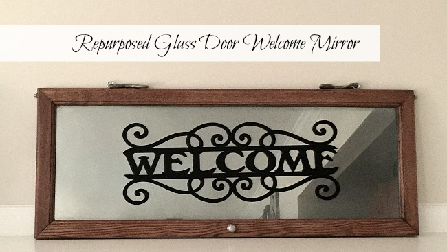 Mirrored welcome sign on repurposed window