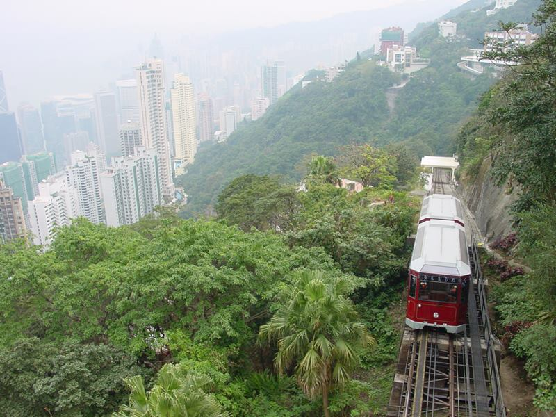 The Peak Hong Kong, The Peak Tramway, is one of the most popular attraction of Hong Kong. The world's oldest and most famous funicular railways. The-Peak-Tramway Victoria-Peak-Hong-Kong world's-oldest-funicular-railways attraction-of-Hong-Kong the-steepest funicular-railway-in-the-world Hong-Kong-Funicular Hong-Kong-Tramway The-Peak-Funicular-Hong-Kong The-Peak The-Peak-Tramway-Hong-Kong Hong-Kong-The-Peak Hong-Kong-Tramway british-rail rail-transport train-journey electric-tram tram-to-victoria-peak
