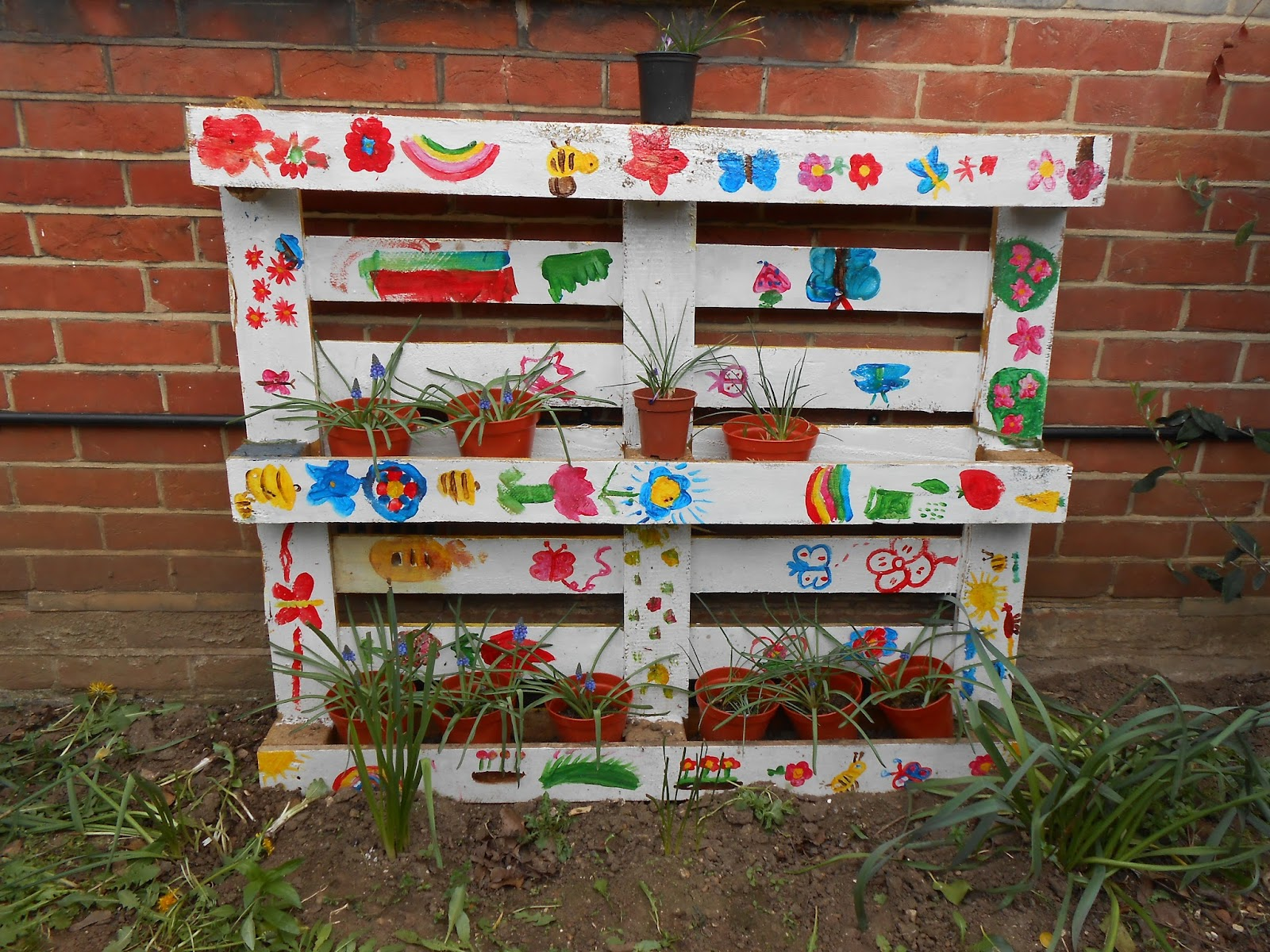 school gardening club pallet used as flowerpot stand