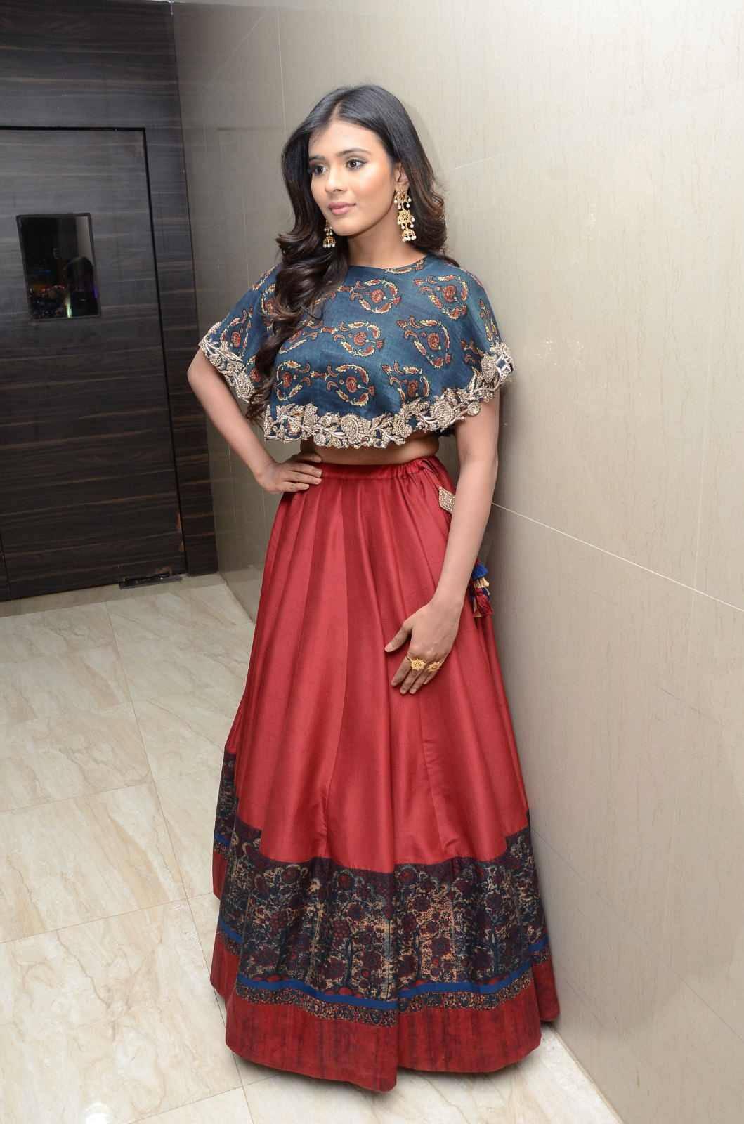 Hebah Patel Hip Show In Blue Top Red Lehenga At Movie Success Meet