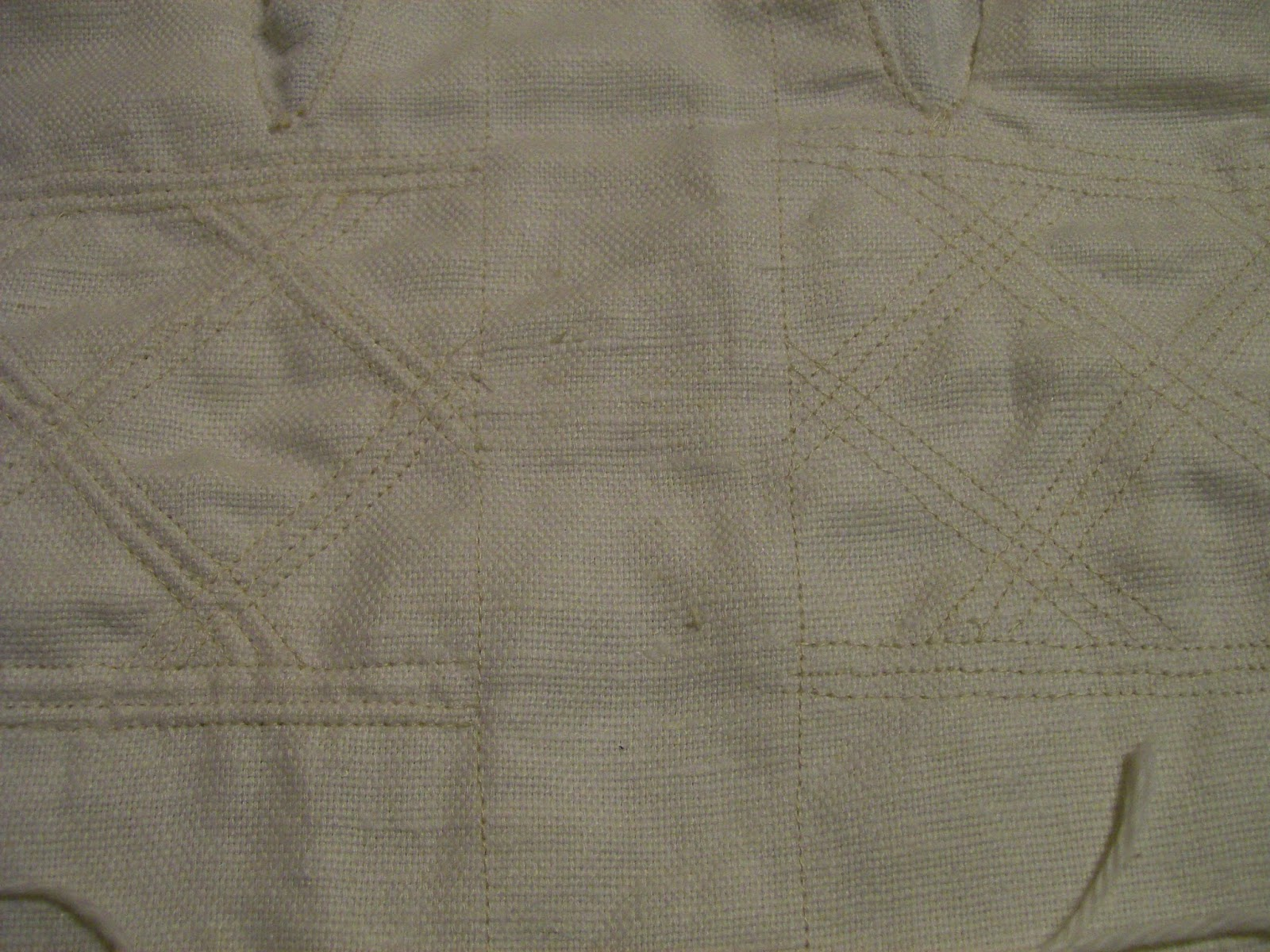 Detail: quilted versus quilted and corded.
