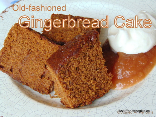 Sliced Gingerbread Cake with apple sauce and cream.