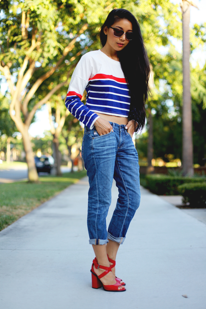 Stephanie Liu of Honey & Silk sharing 3 ways to style the essential red heels. First up, wearing Choies shirt, AG Piper Crop jeans, Paul Frank subtle and sure sunglasses, and Kelsi Dagger Blanca heels