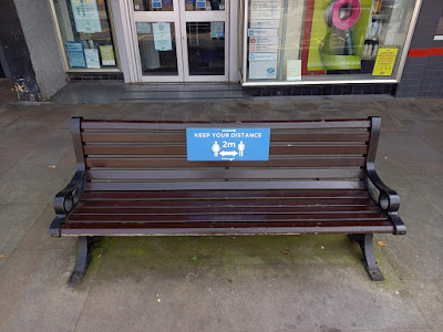 A social distancing sign on a bench in Colne, Lancashire