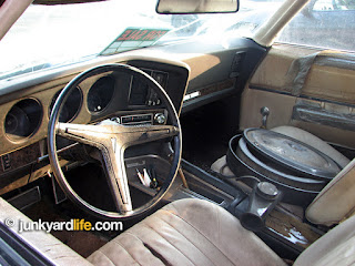 400-V8 air cleaner sits inside the 1969 Grand Prix on the bucket seat.