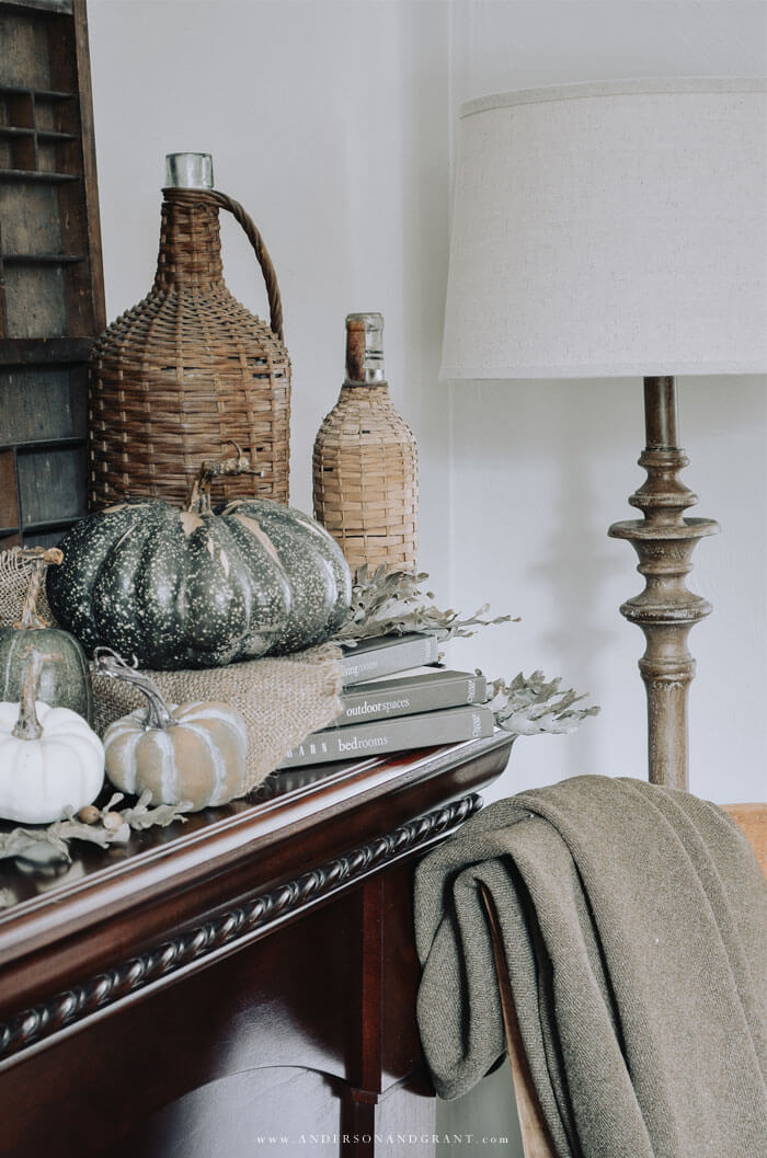 A must see post about creating a warm and cozy fall home with a rustic and neutral design style.