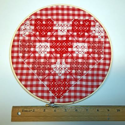 Cross stitched hearts on checked gingham