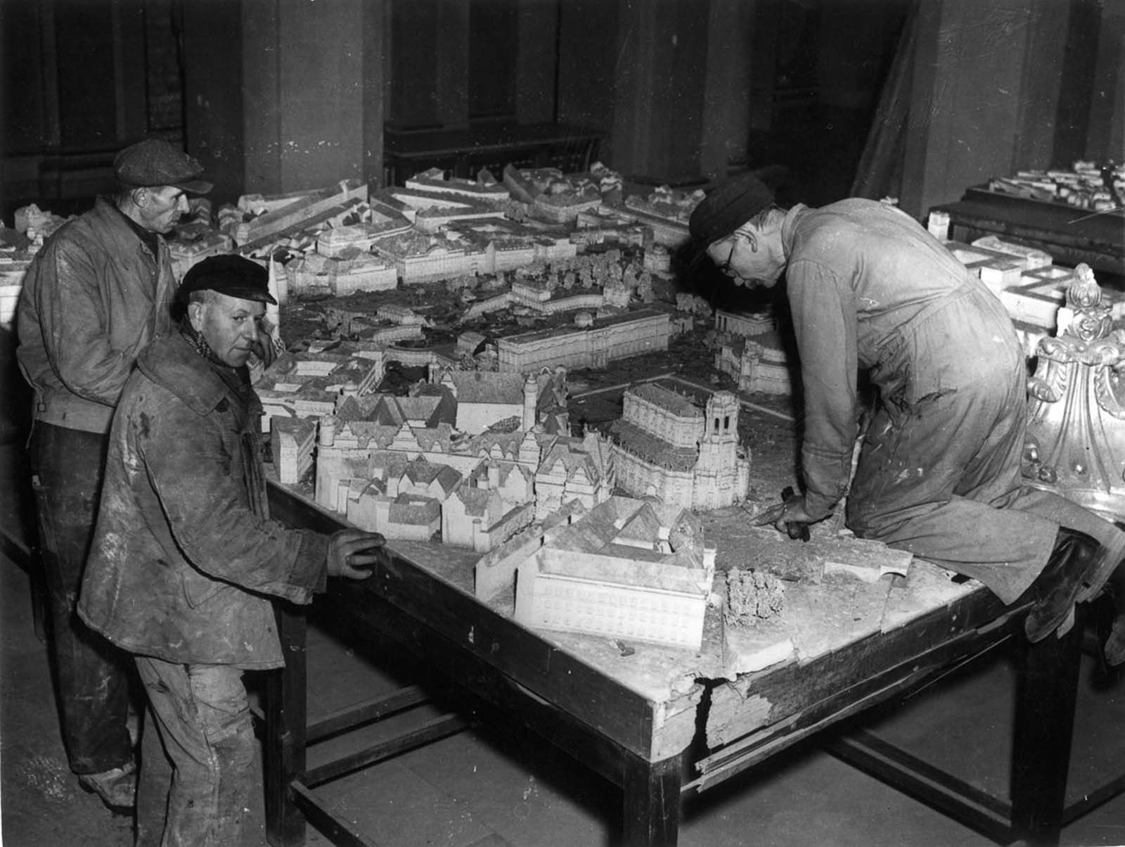Workmen assemble a scale model of Dresden as it should look in 1958 after its reconstruction by the Russian occupying forces. 1946.