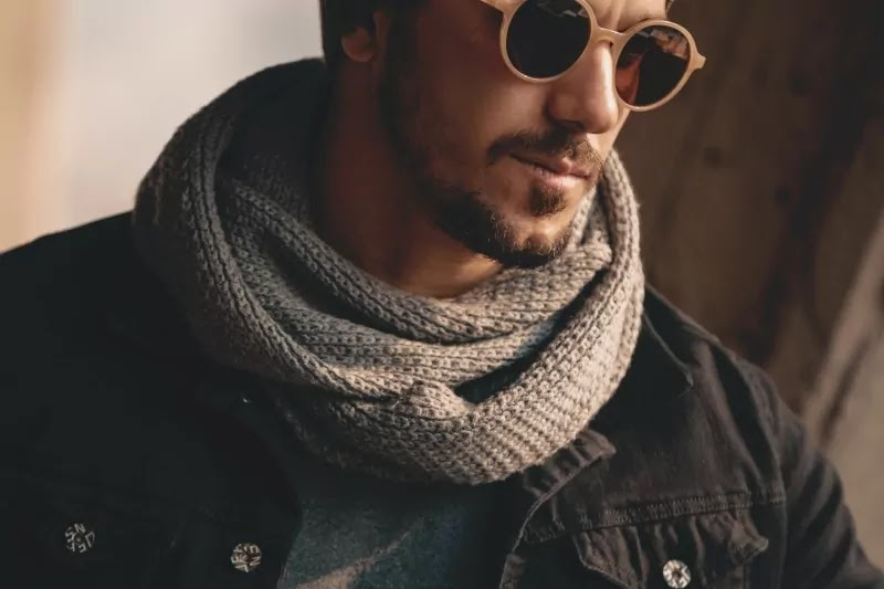 A guy wearing a brown scarf.
