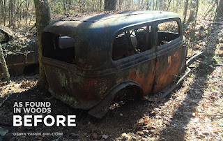 The 1934 Ford race car sitting in dirt down in woods. Rusty, no wheels and left for dead for 40 plus years.