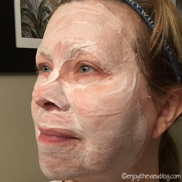 woman with foamy mask on her face