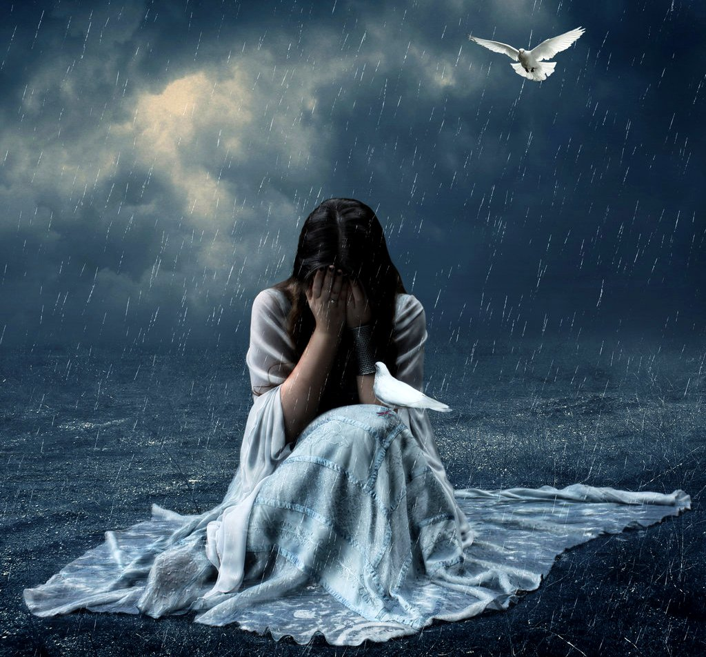 Lonely girl crying with tears in rain thinking of ...