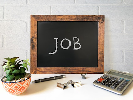 Image of a blackboard with the word job chalked onto it