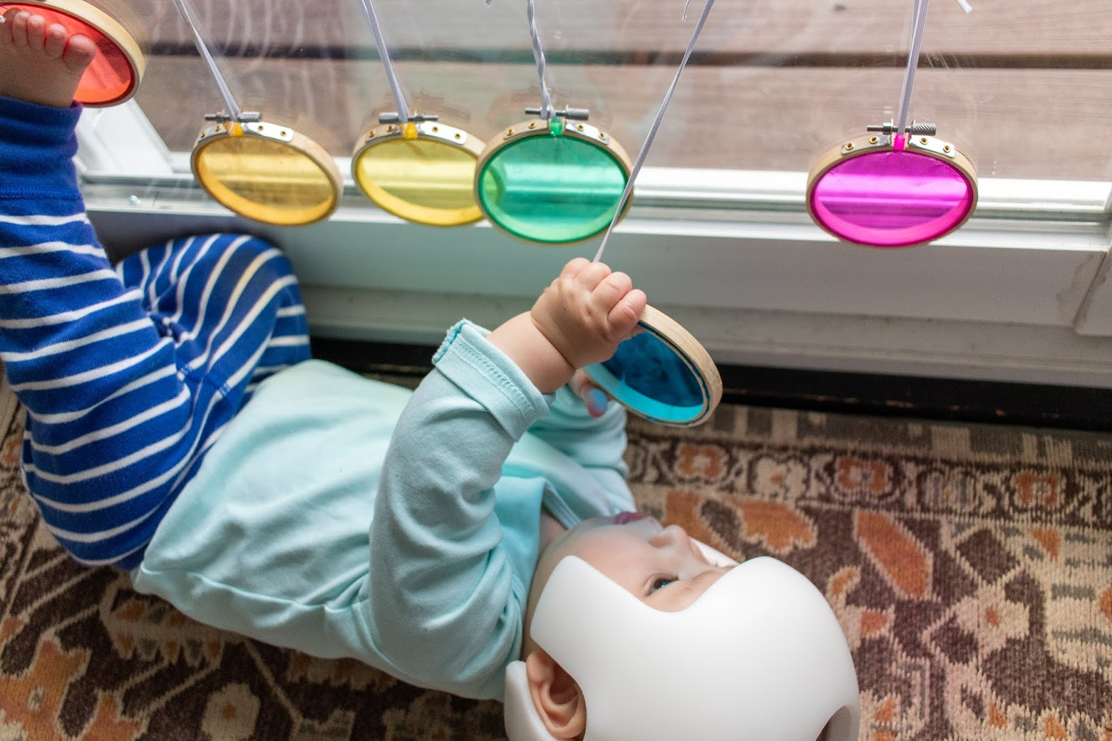 Baby development happens best through sensory rich play and exploration. Here's an easy, baby activity to help your baby explore color.