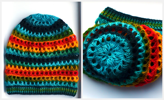 A collage of two photographs side by side. Left is the horizontally striped rainbow slouched beanie laid flat. Right is a top view showing the crown where nine broomstick lace loops form a star or daisy shape around a central round eyelet.  The stripes are made of broomstick lace loops. The colours recure in a basic sequence of light blue-dark blue-llight blue - green - yellow / orange - red - yellow / orange - green.