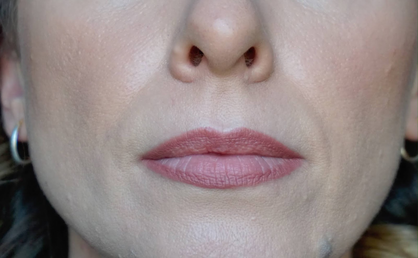 Half of face with lip liner applied to lips