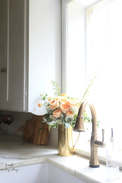 champagne bronze kitchen faucet with marble counters