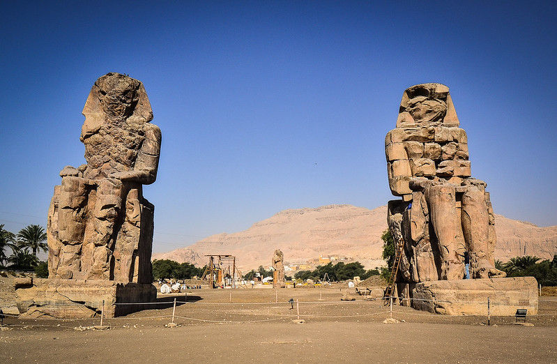 colossi of memnon; the colossi of memnon; colossal seated statue of a pharaoh; colossus egypt; colossi of thebes; memnon's mother; colossi of memnon egypt; colossi of memmon; kolosse von memnon; singing statues; god memnon; colossi of memnon statue; memnon egypt; colossus of memnon egypt; colossi of amenhotep iii; singing statues egypt;